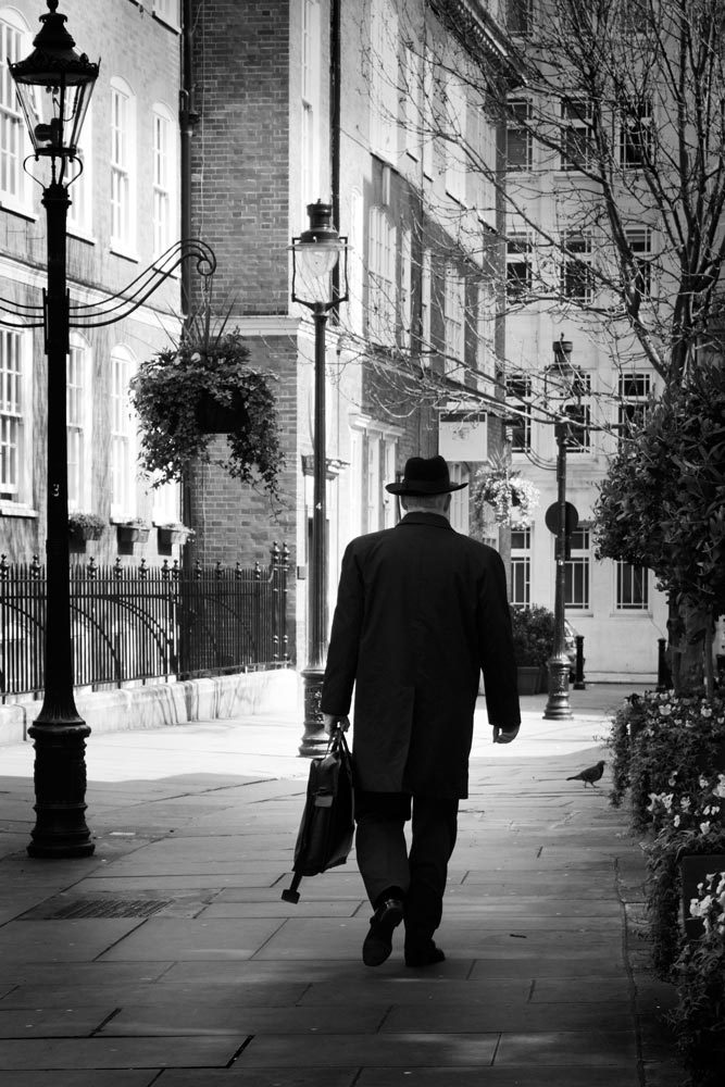 Man with hat walking in London Street