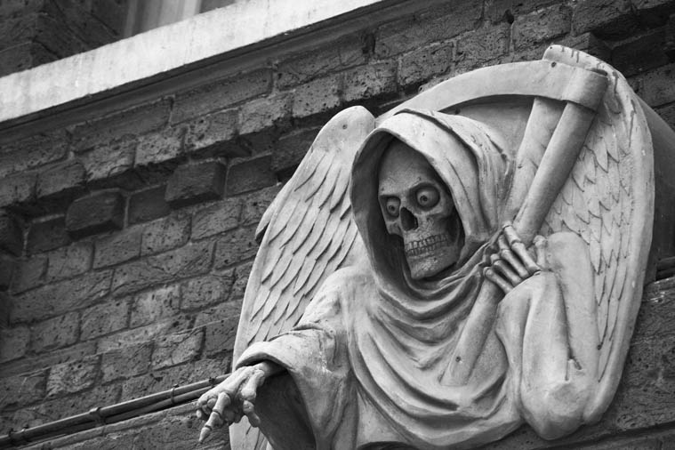 Death statue in London during ghost tour